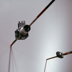 "MadeIn Company, ""Focus,"" camera and aboriginal spear, dimensions