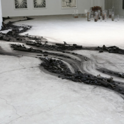 "Shi Jinsong, ""Over There"", locust tree and a number of animal skeletons made into charcoal, installation, variable in size, 2011史金淞,《那边》,装置,碳化一棵树和若干动物的骨骼,2011"