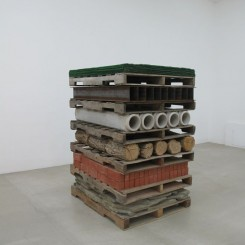 "Charles Harlan, ""Pallets"", stone, brick, wood, concrete, steel, astro turf, 166.4 x 123.2 x 102.9 cm, 2013"