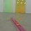 """Ann Veronica Janssens """"Untitled"""", glass, 12 x 180 x 12 cm, 2015 (foreground) with """"Magic Mirrors (Green & Pink #2)"""" (background), both glass, 200 x 100 x 1.8 cm, 2015 at Esther Schipper gallery (photo: Chris Moore)"""
