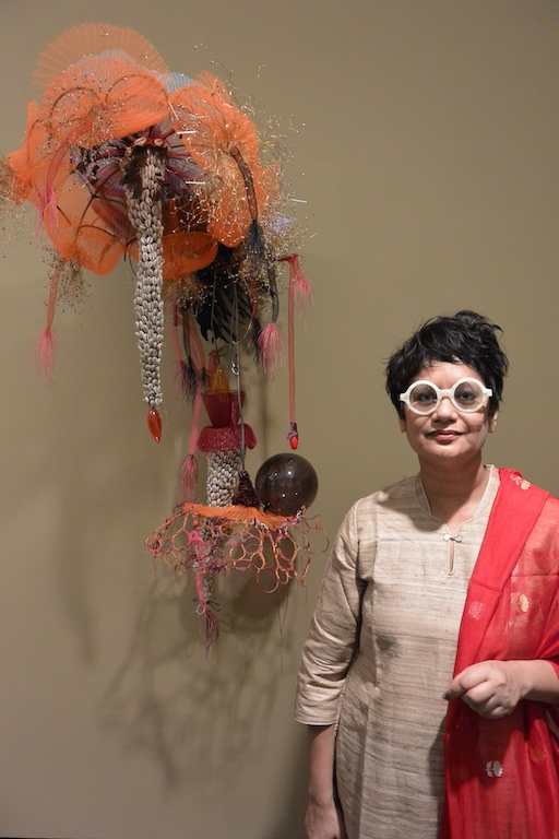 Rina Banerjee at her exhibition opening for