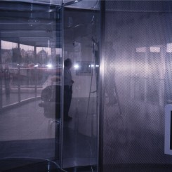 "Dan Graham, ""Waterloo Sunset"" at the Hayward Gallery, London, stainless steel, two-way mirror glass, 2002-2003."