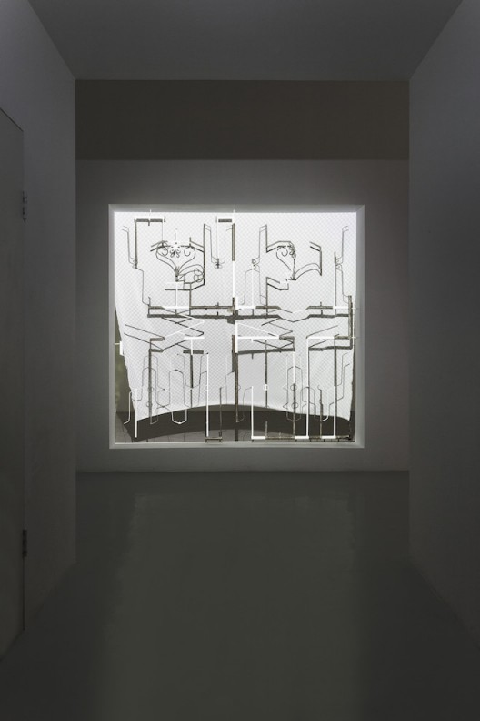 Liu Chuang, What is A Screen?, 2015, Installation, Iron, paint, projection, electric fan, printed cloth, 220×210cm, Courtesy the artist and Magician Space