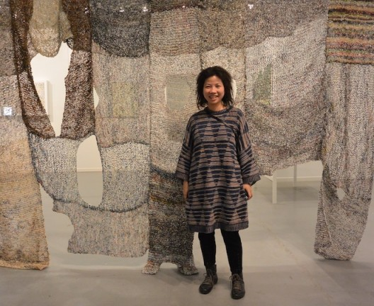 Movana Chen with her knitted shirts of shredded magazines, at Australia China Art Foundation (ACAF), Shanghai