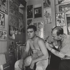 "Danny Lyon, ""Bill Sanders, Tattoo Artist, Houston, Texas, 1968"". Vintage gelatin silver print, 20.7 × 20.7 cm. Collection of the artist. © Danny Lyon, courtesy Edwynn Houk Gallery, New York"