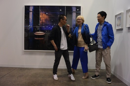 Jiang Pengyi, Karen Smith and Chen Wei, in front of Chen Wei's work, at Blindspot (Hong Kong)