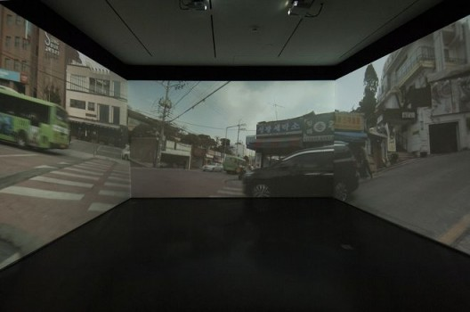 Passage/s: The Pram Project, 2015, three-channel video, dimensions variable. Installation view, Contemporary Arts Center Cincinnati. Photo by Tony Walsh. Courtesy the artist, Lehmann Maupin, New York and Hong Kong, and Contemporary Arts Center Cincinnati.