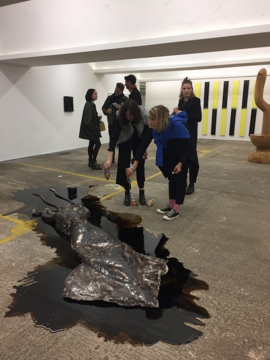 David Zink Yi's squid has a drink at the opening of König Archiv & Souvenir in the converted carpark of Winchester House, Marylebone Road.