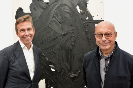 Axel and Boris Vervoordt in front of a work by Gutai artist, Kazuo Shiraga, at frieze London 2018 (photo Chris Moore)