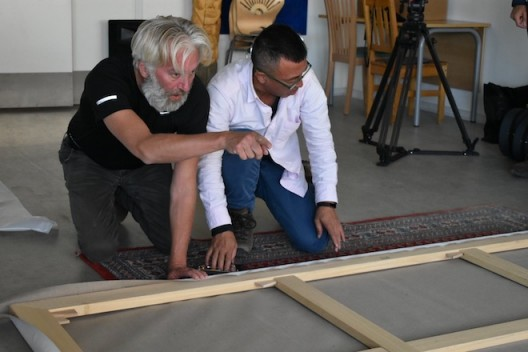 Liu Xiaodong and Jens stretching the canvas for a painting made on their expedition to Greenland July 2017