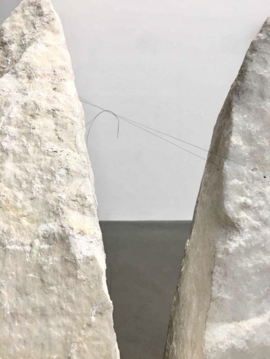 Cao Yu, The World is Like This for Now (detail), 2017, single long hair (the artist's), marble, two pieces, 89 x 61 x 38 and 74 x 50 x 33 cm. Image courtesy the artist and Galerie Urs Meile