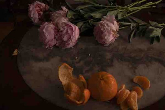 Wei Leng Tay, 5 pink peonies, China. 2 Honey Murcott mandarins, Australia. 1 marble and rosewood table circa 1950s, China. 10 sec, f20, 320 ISO, 37mm. Tungsten light source from right. 11/12/2019, 7.09pm, Singapore, 2019, archival pigment print,53.5 x 73.5 cm (framed). Courtesy the artist.