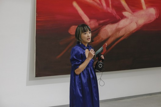 Curator Weng Xiaoyu at the opening