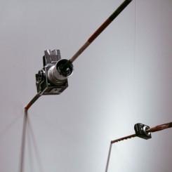 "MadeIn Company, ""Focus,"" camera and aboriginal spear, dimensions variable, 2011 (ShanghART Gallery).  没顶公司, ""聚焦,"" 相机, 长矛, 2011 (香格纳画廊)。"