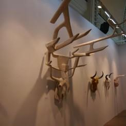 Series of skull-like sculptures by MadeIn, Wang Xieda, Liu Chuyun, Liu Weijian, Lin Tianmiao, Qiu Zhijie, Yuan Yuan, and Qiu Xiaofei. James Cohan Gallery booth.