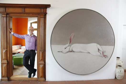 Uli Sigg at home with Shao Fan's Moon Rabbit, 2010, oil on canvas, dia. 220 cm (image HUG Karl-Heinz)