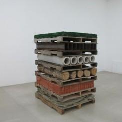 "Charles Harlan, ""Pallets"", stone, brick, wood, concrete, steel, astro turf, 166.4 x 123.2 x 102.9 cm, 2013"