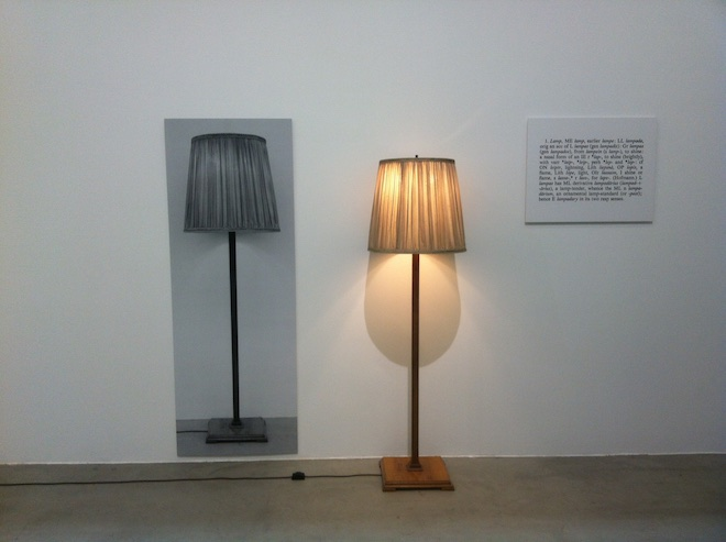 """Joseph Kosuth """"One and Three Lamps"""", 2 black and white photographs mounted on board, lamp, dimensions variable, 1965 (copyright Joseph Kosuth/ ARS, New York; courtesy: the artist and Sprüth Magers, Berlin, London)."""
