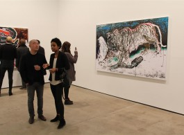 """Sun Xun (L), talks to a visitor at the opening of """"The Time Vivarium"""" at Sean Kelly Gallery, New York."""