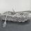 """Yayoi Kusama, """"Walking on the Sea of Death,"""" sewn stuffed fabric, fiberglass rowboat, silver paint, 58 x 256 x 158 cm, 1981."""