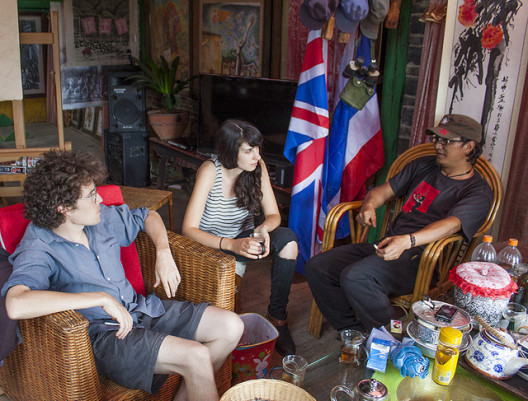 Kira Simon-Kennedy with Jay Brown of Lijiang Studio and a local artist