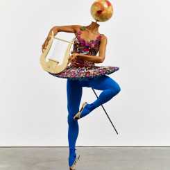 """Yinka Shonibare, """"Ballet God (Apollo)"""", fibreglass mannequin, Dutch wax printed cotton textile, lyre, sword, globe, pointe shoes and steel baseplate, 193 x 86 x 85 cm, 2015."""
