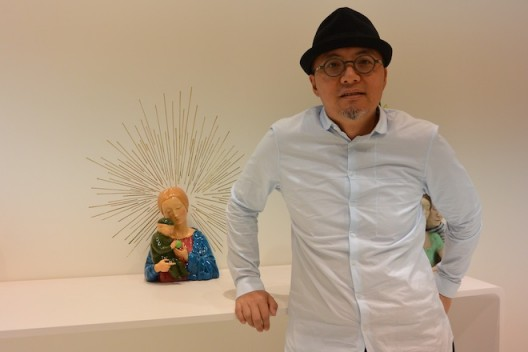 Qu Guangci with one of his sculptures. 瞿广慈和他的一件雕塑