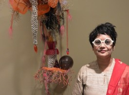 """Rina Banerjee at her exhibition opening for """"Migration's Breath"""" at Ota Fine Arts, Singapore, 2015. (Photo: Chris Moore)."""