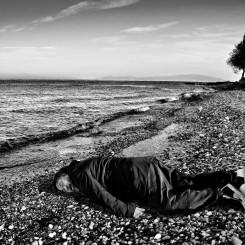 Chinese artist Ai Weiwei imitating the lifeless body of Syrian toddler Alan Kurdi on the Greek Island of Lesbos. (Rohit Chawla for India Today)