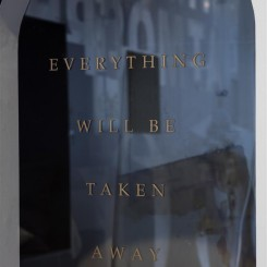 """Adrian Piper, """"Everything #5.1"""", plexiglass wall insert engraved with gold leaf text, 2004.© APRA Foundation Berlin. Photo: Timo Ohler"""