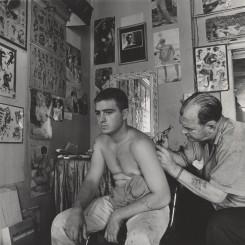 "Danny Lyon, ""Bill Sanders, Tattoo Artist, Houston, Texas, 1968"". Vintage gelatin silver print, 20.7 × 20.7 cm. Collection of the artist. © Danny Lyon, courtesy Edwynn Houk Gallery, New York"