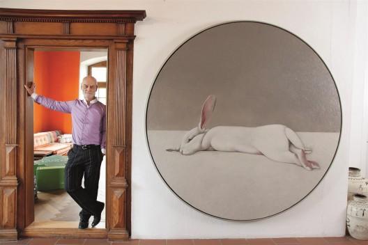 Uli Sigg next to the painting,