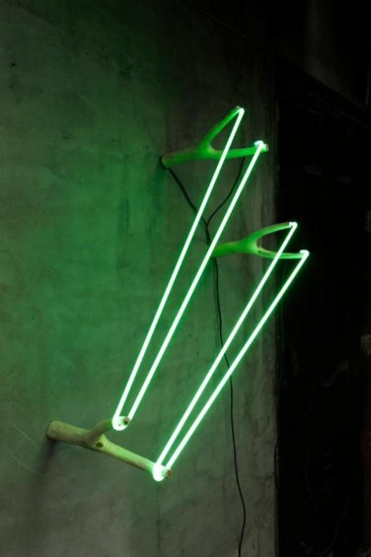 Zhou Wendou, Three Catapults, 2017. Wood, neon light, transformer, 74 x 40 x 30 cm
