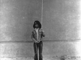Keiji Uematsu, Stone/Rope/Man II,1974, Gelatin silver print, vintage 120 x 89 cm (47 1/4 x 35 1/8 in.) Edition 1 of 3. Courtesy the artist and Simon Lee Gallery.