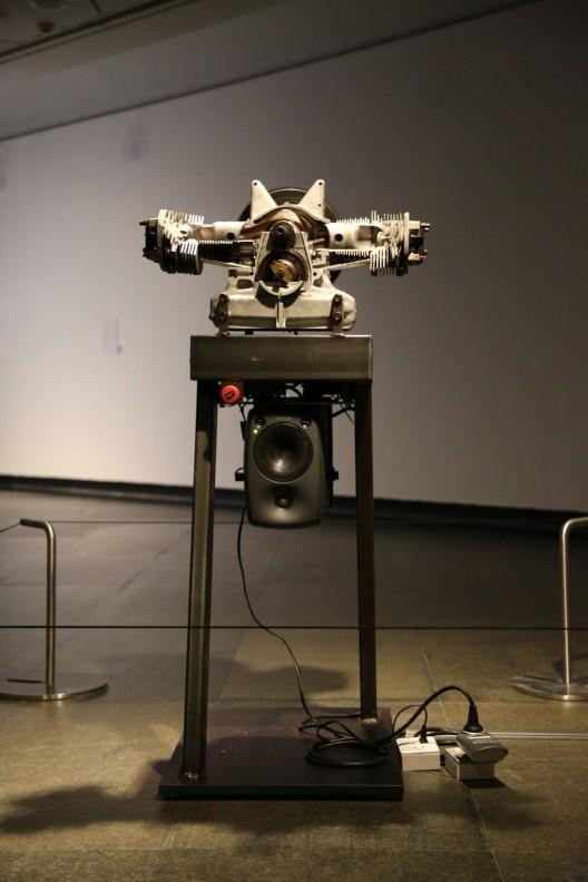 "Thomas Bayrle, ""Rosaire"", 2 CV motor, cut off, sound installation, 117 cm × 65 cm × 50 cm, 2012"