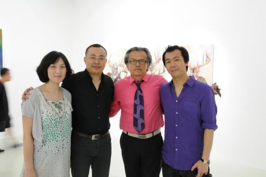 The artist GORDON CHEUNG pictured (furthest right) at his 2010 solo exhibition at Shanghai's Other Gallery with, from right to left, curator RAUL ZAMUDIO, Other Gallery owner and How Art Museum founder ZHENG HAO, and Zheng's wife. Courtesy the artist.